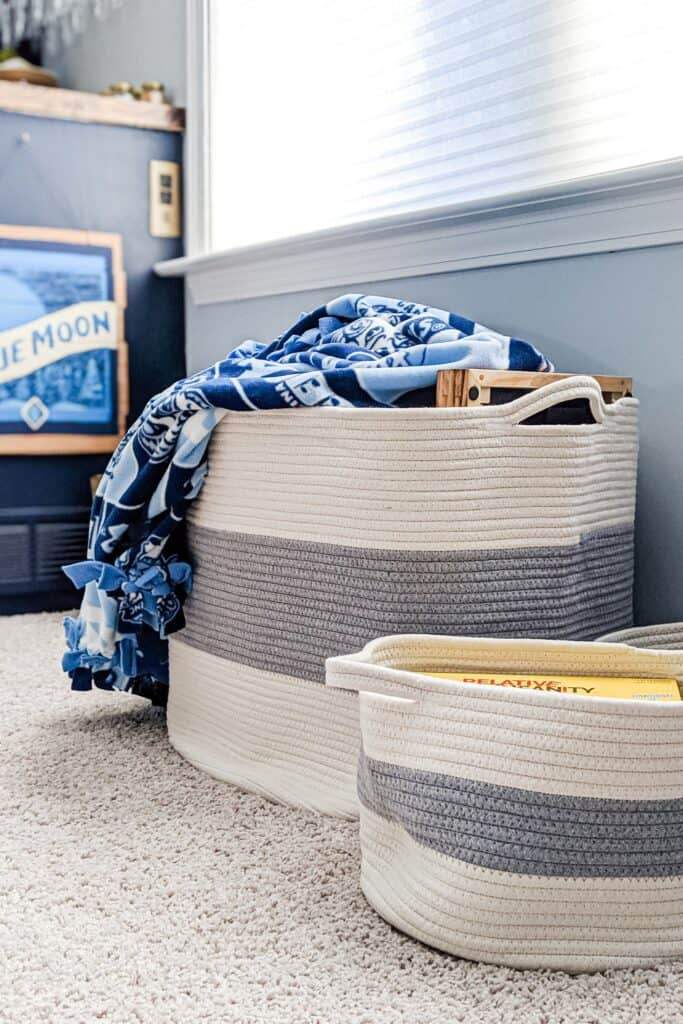 blue and white striped baskets holding board games