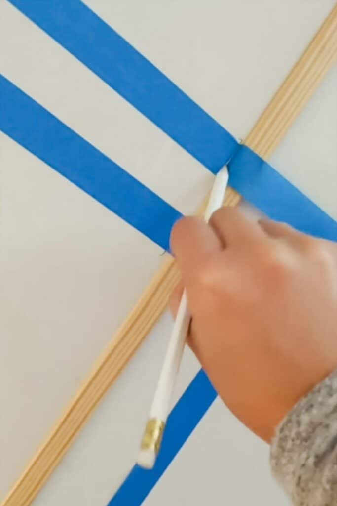 cutting tape using a pencil