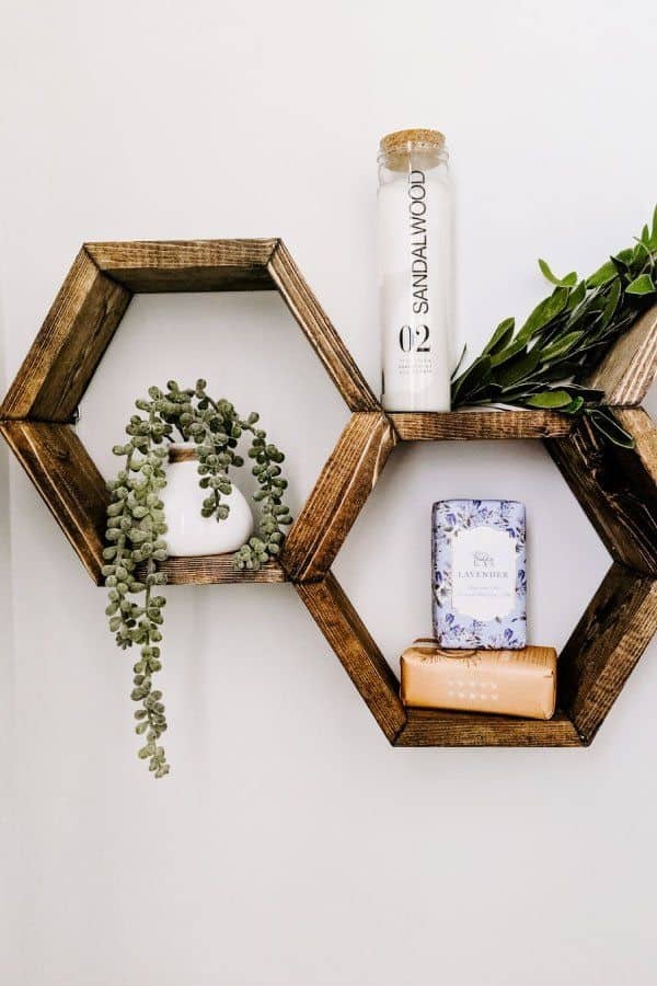DIY hexagon shelves decorated with soap and faux plants