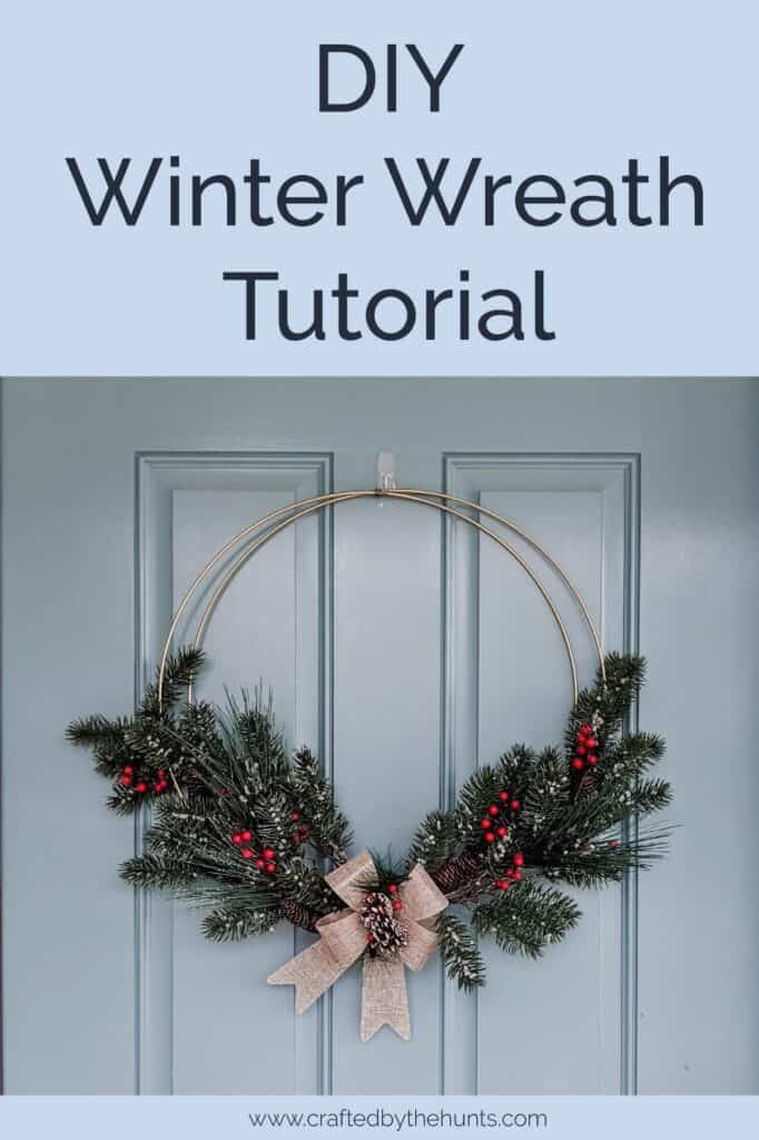 DIY winter wreath hanging on blue front door