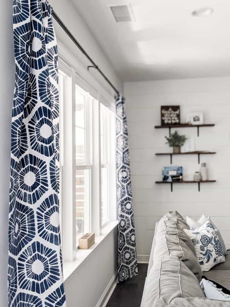 DIY stenciled curtains with dark blue geometric pattern