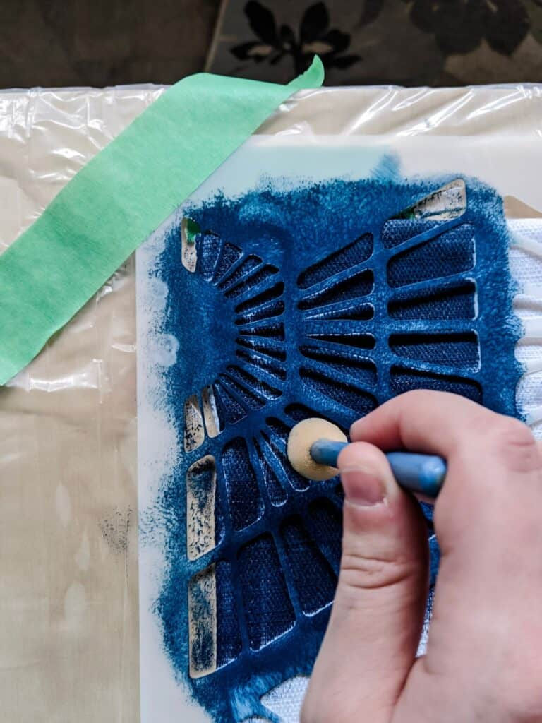 Painting a curtain using a stencil brush