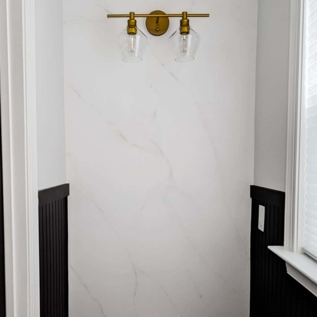 DIY painted marble wall with gold light