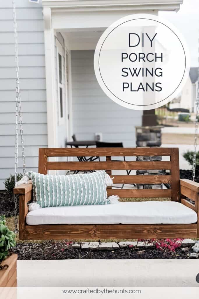 DIY porch swing made from wood and topped with a white cushion and blue pillow
