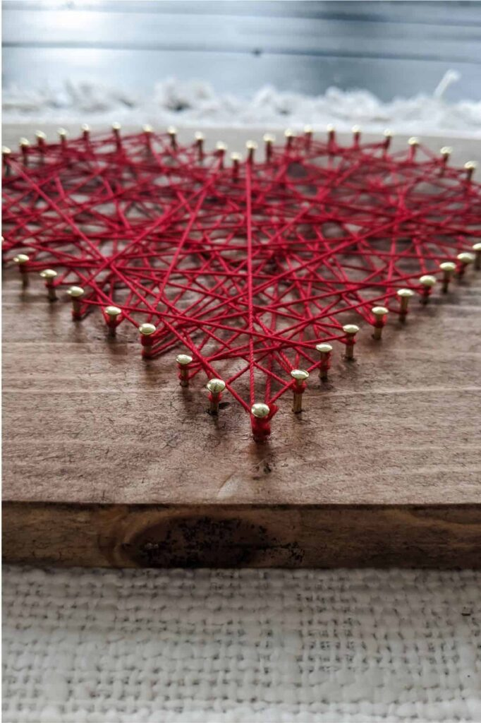 close-up on DIY string art heart