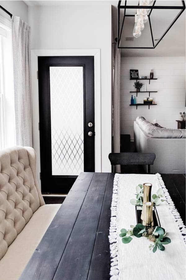 black painted door with window film in farmhouse style dining room