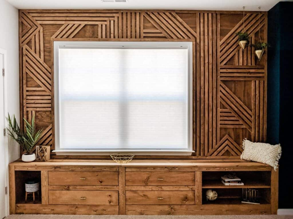 geometric wood accent wall with window seat