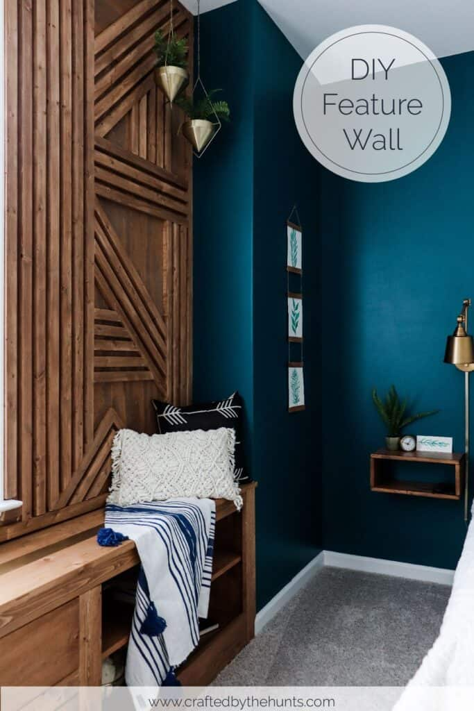 Wood accent wall next to dark blue wall in bedroom
