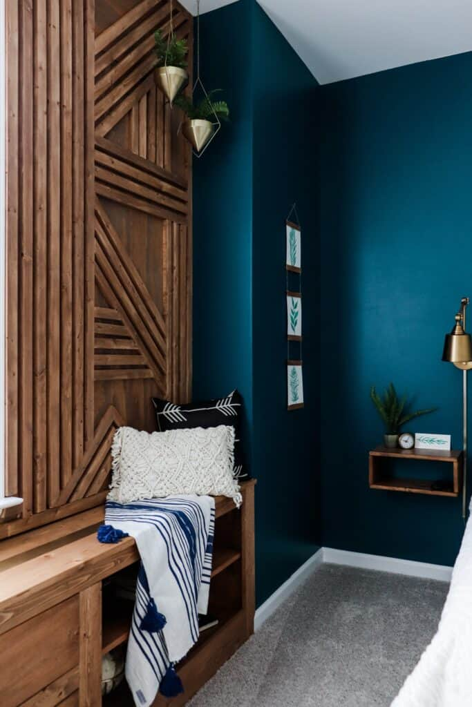 geometric wood wall with dark blue accent wall