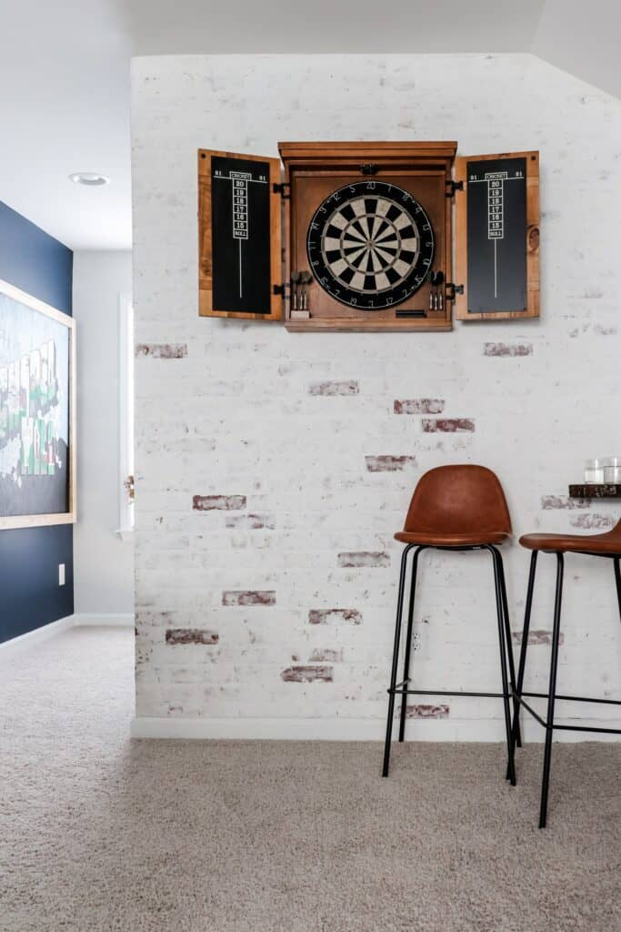 Faux brick wall with DIY german schmear finish and dart board