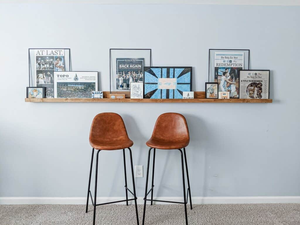 photo ledge with two leather bar stools