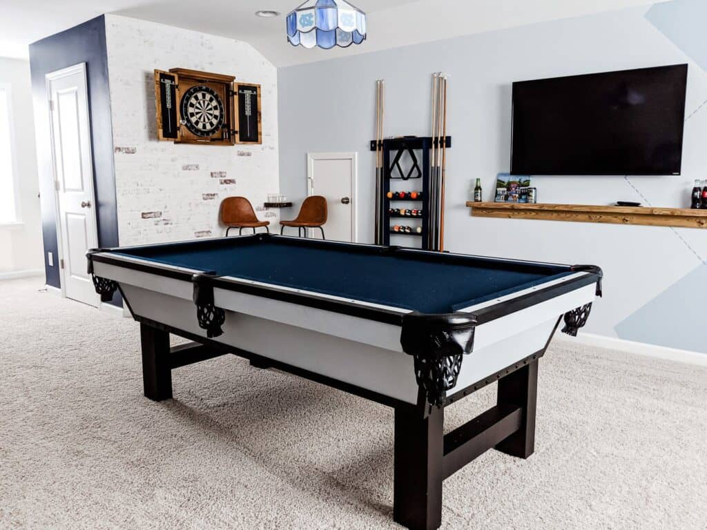 modern pool table with blue felt in modern game room