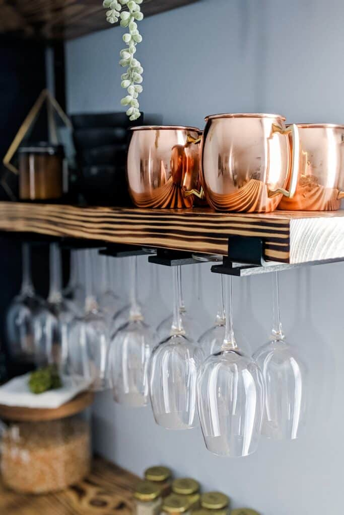 close-up of wine glass holder under shelf