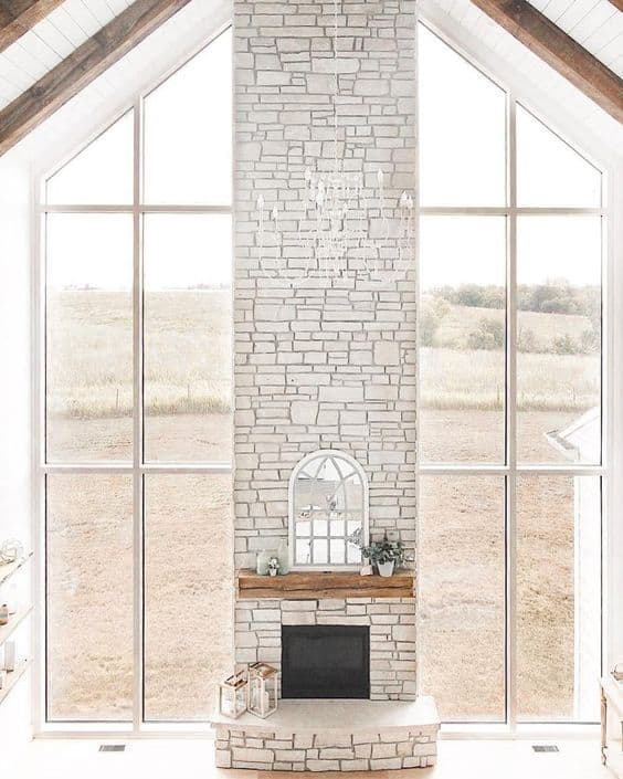 stone fireplace with tall ceilings
