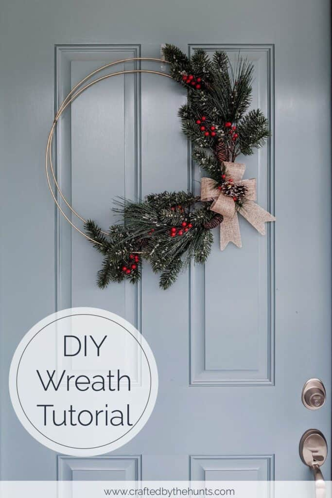 DIY wreath hanging on blue front door