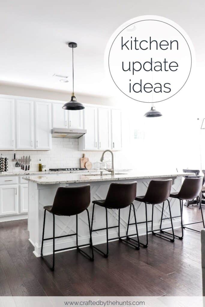 white kitchen with leather barstools and black pendent lights