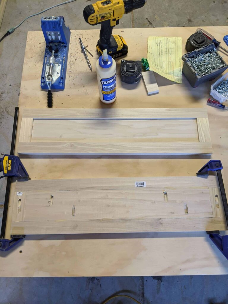 DIY shaker cabinet doors in progress using clamps and pocket holes