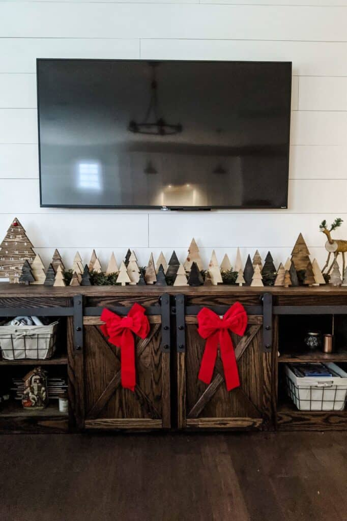 wood tv console with wood christmas tree forest