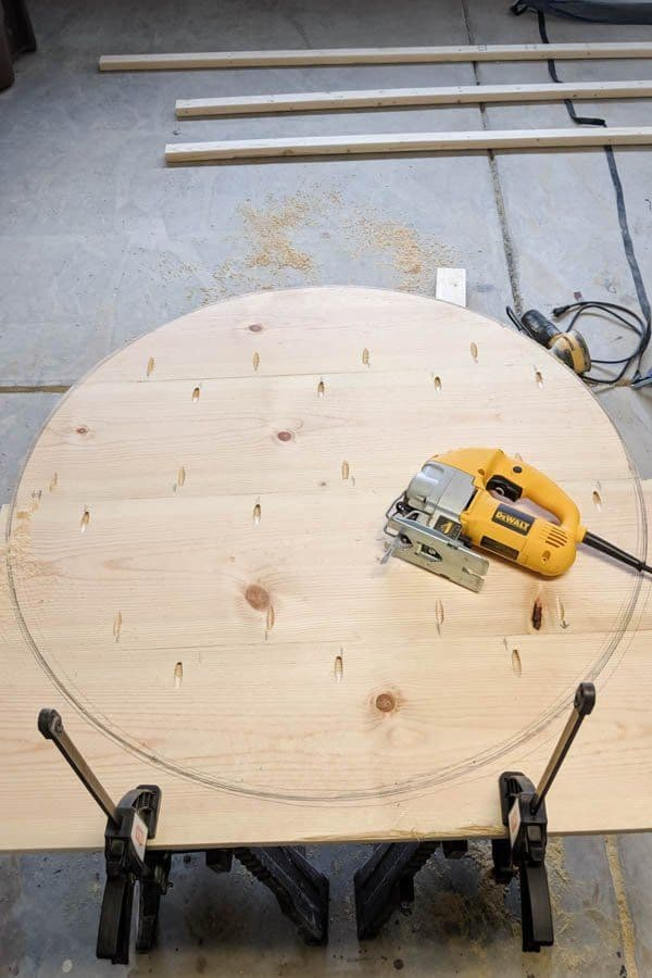 cutting a large piece of wood into a circle using a jigsaw