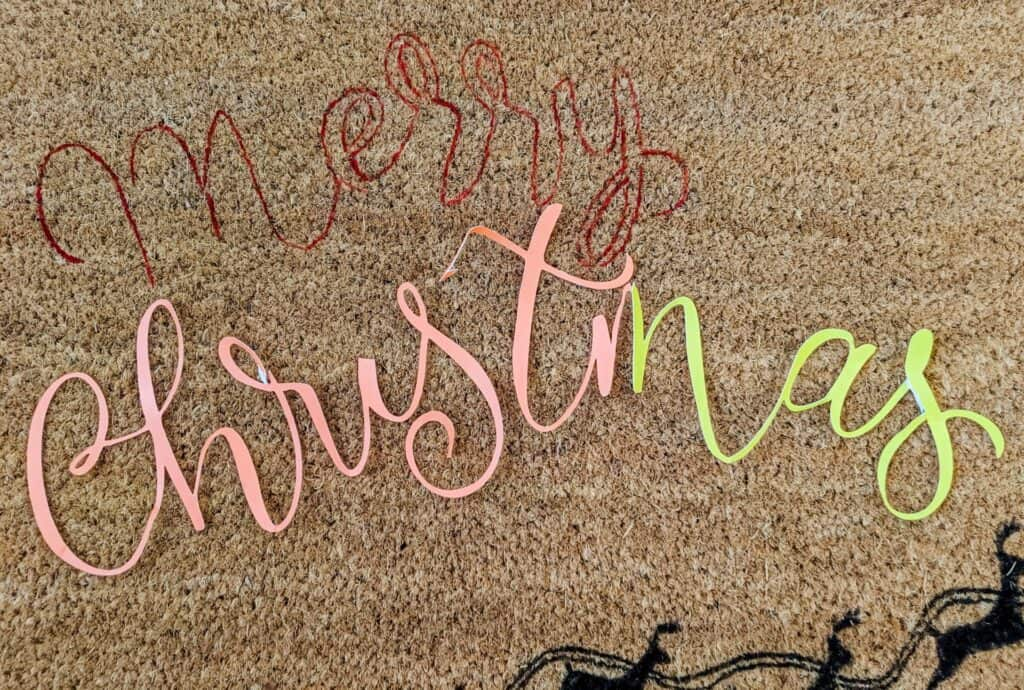 tracing letters onto a doormat with paint