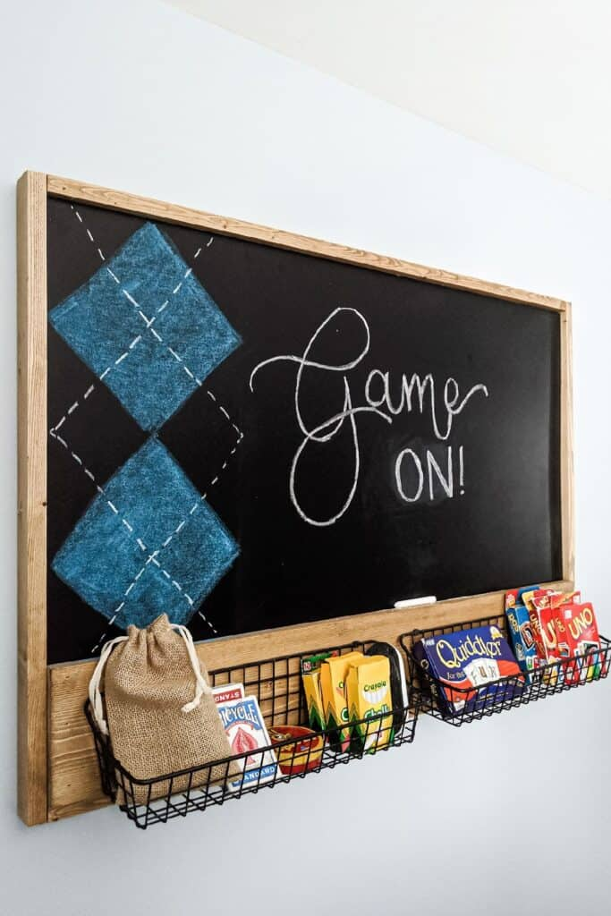 chalkboard with metal storage baskets