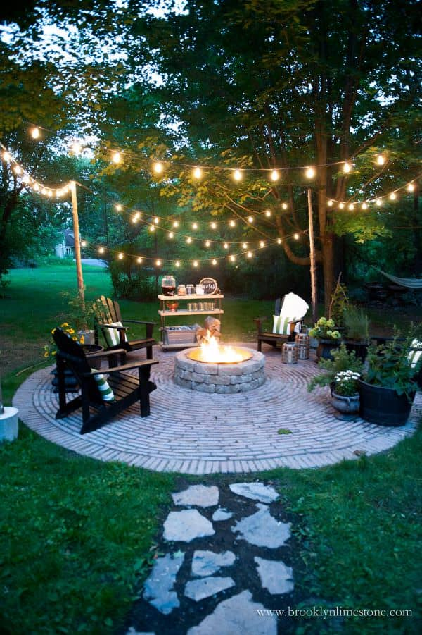 string lights over outdoor fire pit