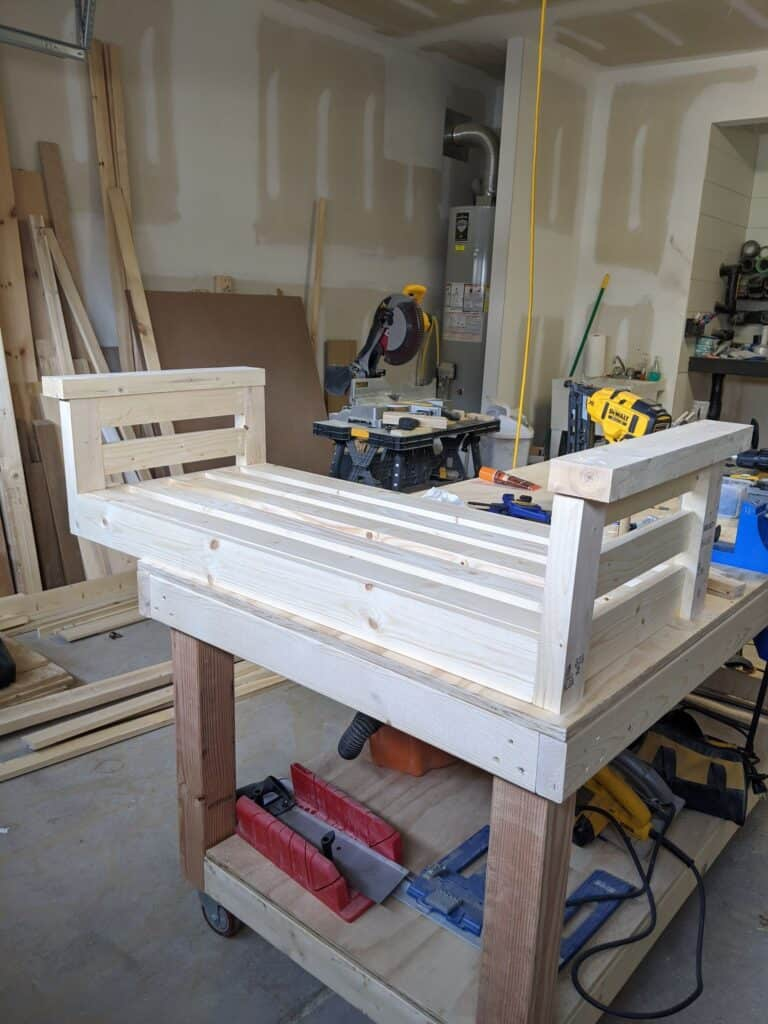 Add arms to wood porch swing