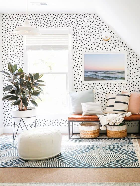 polka dot accent wall in playroom