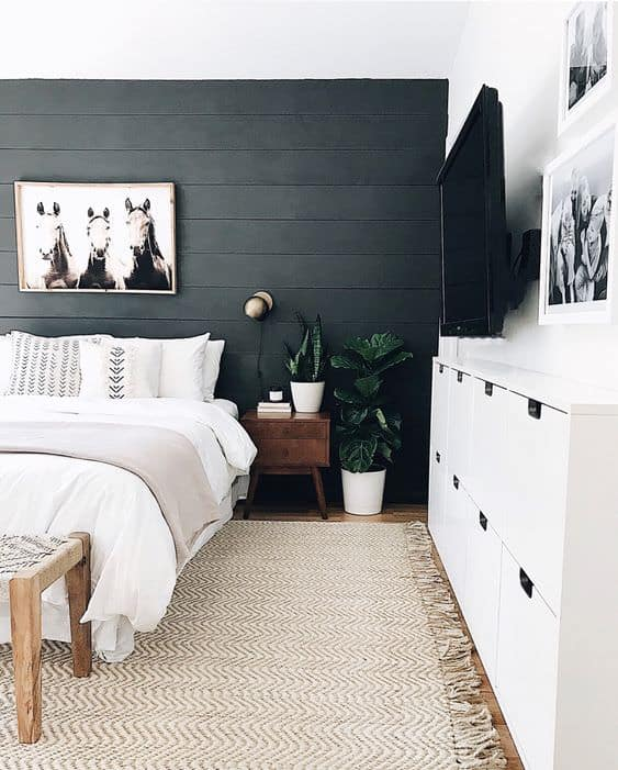 black shiplap accent wall in bedroom
