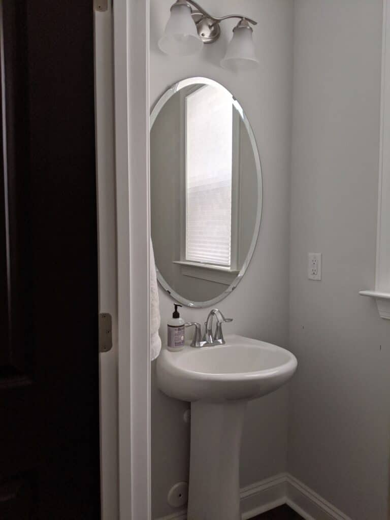 bland builder grade powder room with pedestal sink