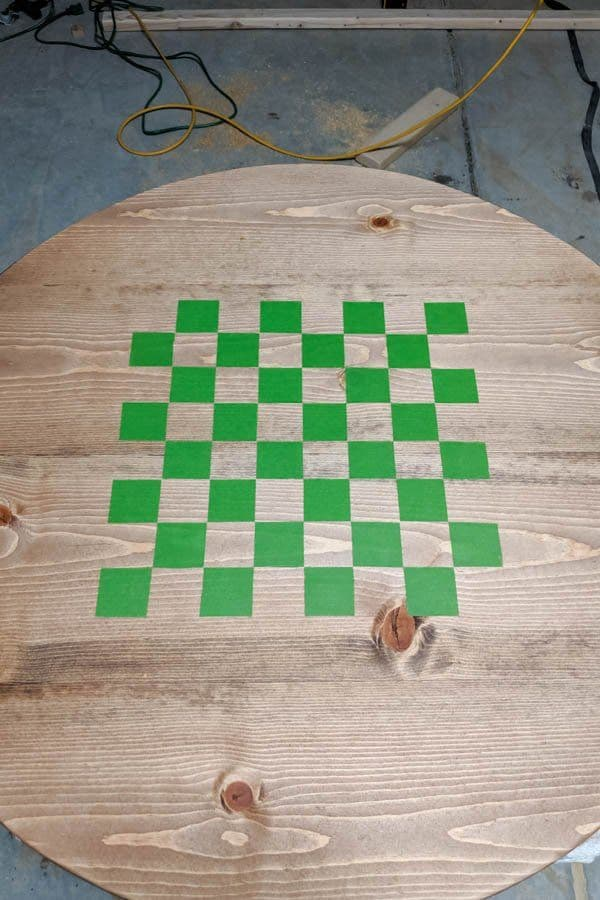 checkerboard pattern on wood table with tape