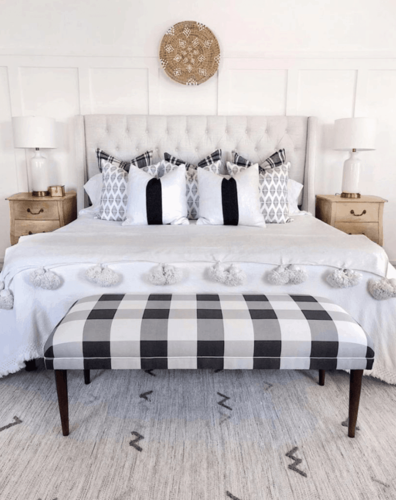 tufted headboard in black and white bedroom