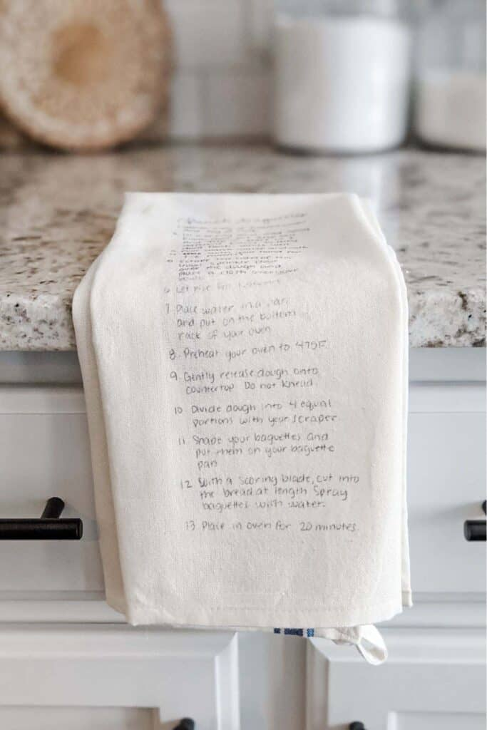 handwritten recipe towel sitting on kitchen countertop