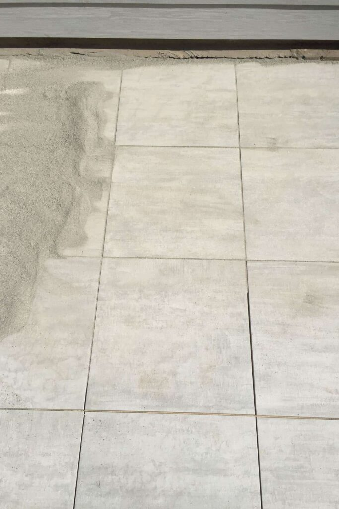 adding polyermic sand to porcelain paver patio