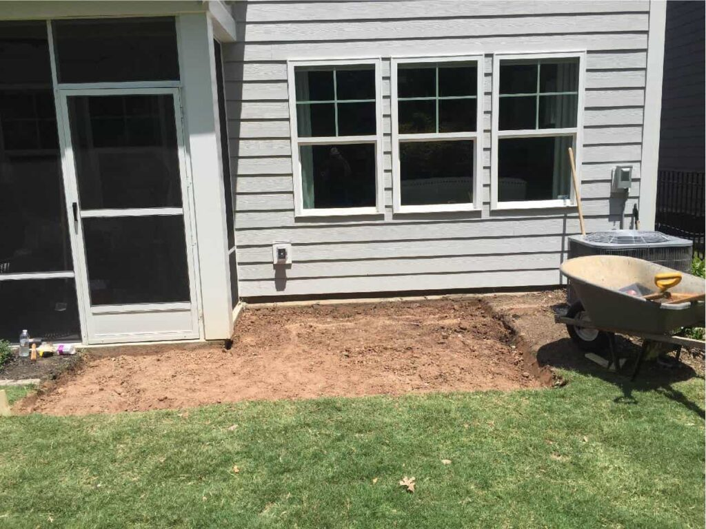 backyard with hole dug from patio