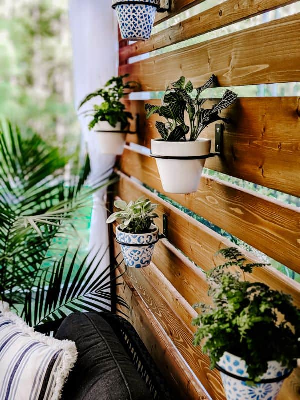 close-up of wood planter wall with hanging planters