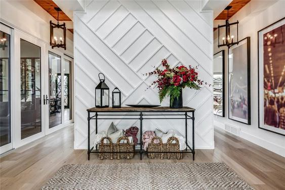 geometric white accent wall in grand entryway