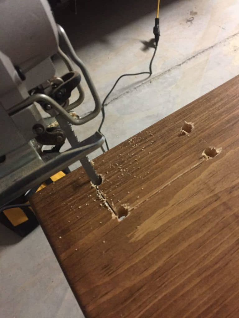 using a jigsaw to cut a rectangle out of wood