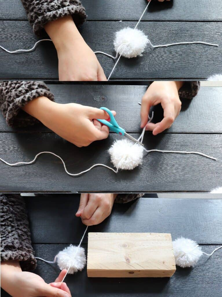 stringing DIY pom poms together to make a garland