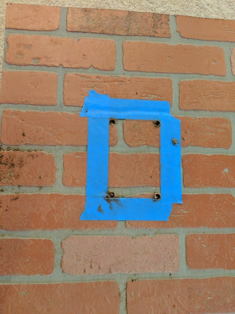 cutting outlet from faux brick wall