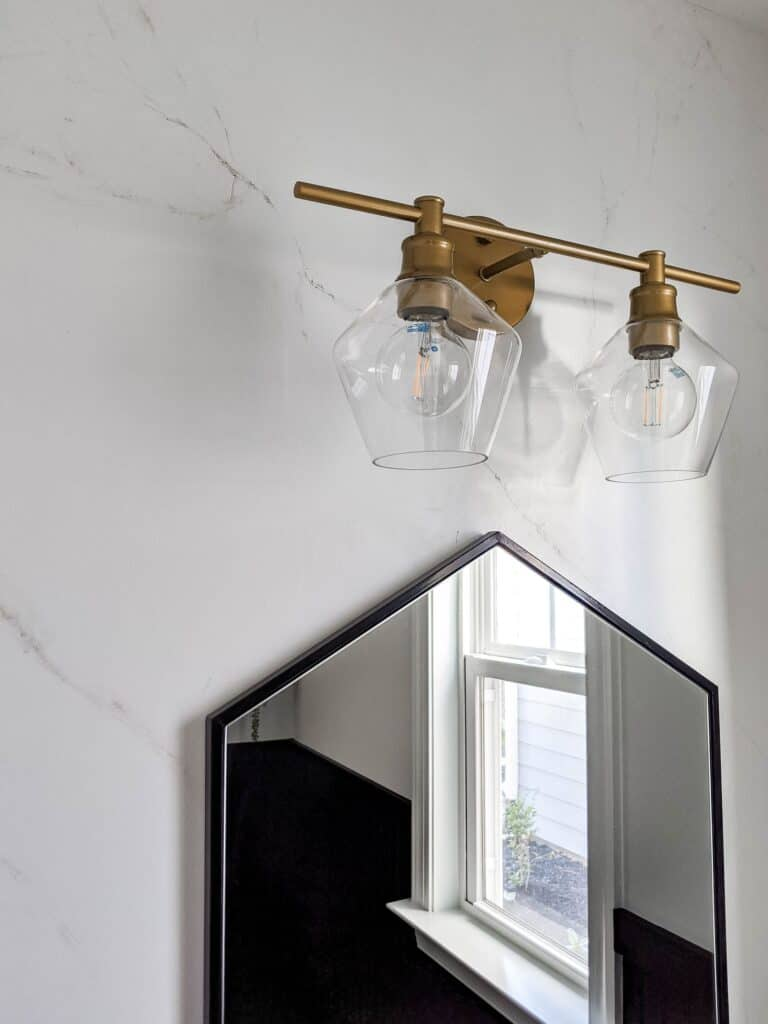 Painted marble wall with gold and glass light fixture