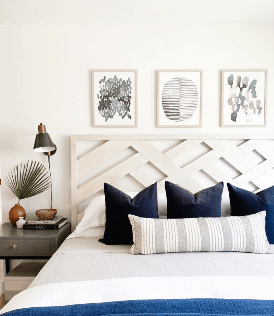 simple woven wood headboard in light and airy bedroom