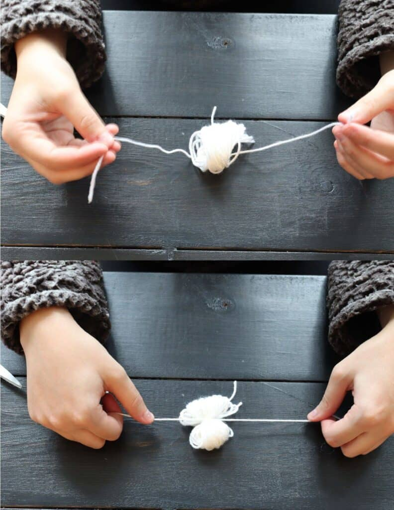 tie yarn to make a diy pom pom