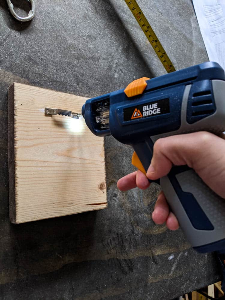 attaching sawtooth hanger to back of wood using Blue Ridge tools