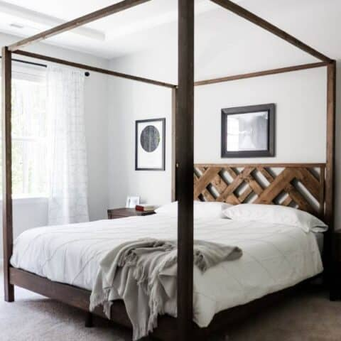 Canopy bed with wood headboard and white bedding
