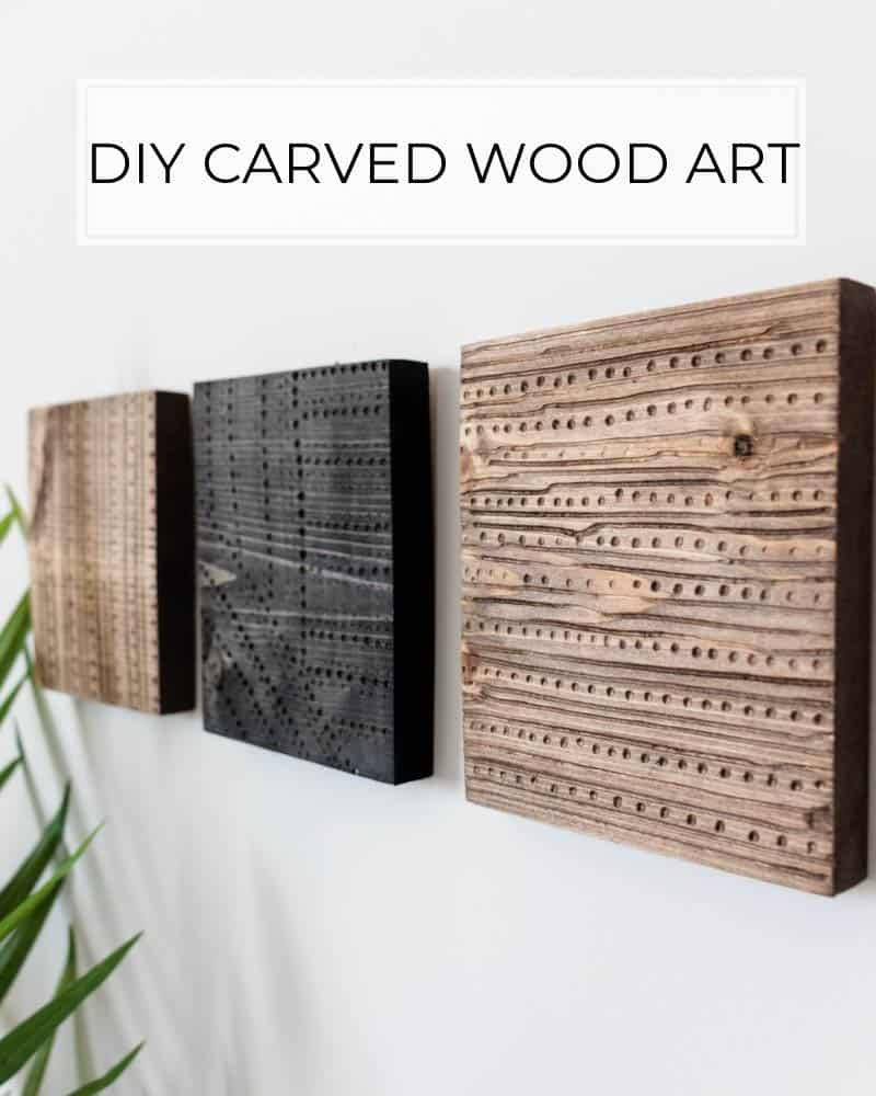 DIY carved wood art hanging on white wall