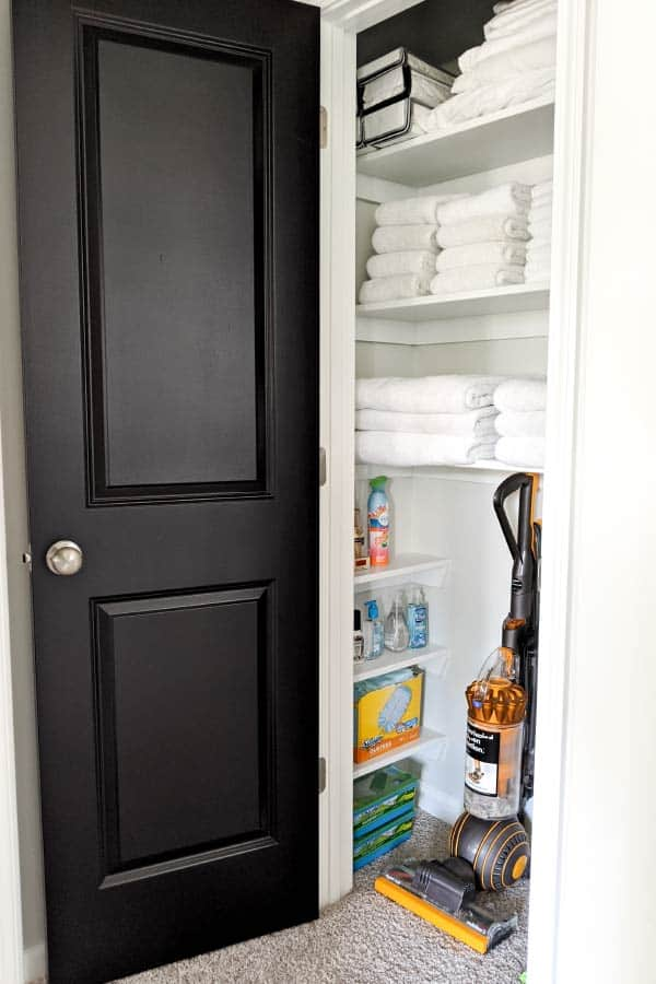laundry room closet with built-in shelving