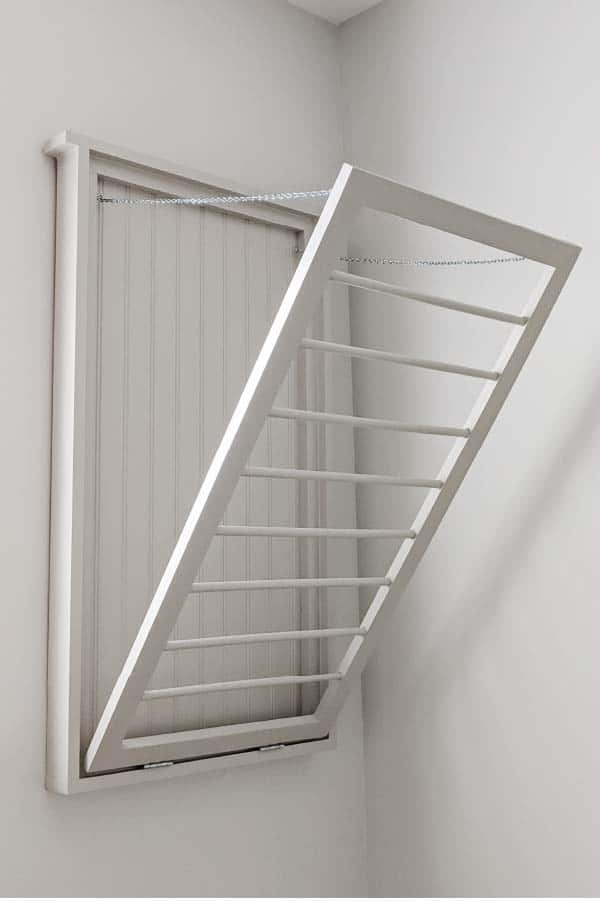 light gray fold down drying rack with beadboard back