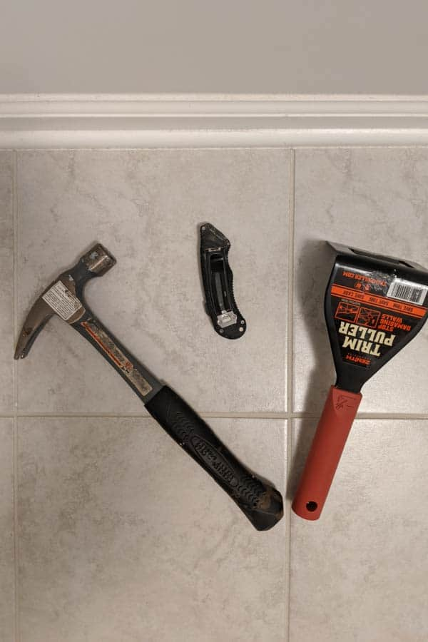 utility knife, hammer, and trim puller