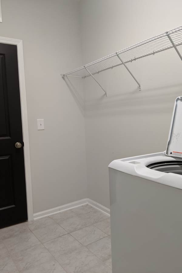 empty laundry room with open air shelving